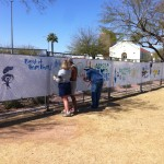 Vickie, Ed, and K.D. painting the fence at the Blues Blast