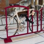 A sleek red bike rack on display.