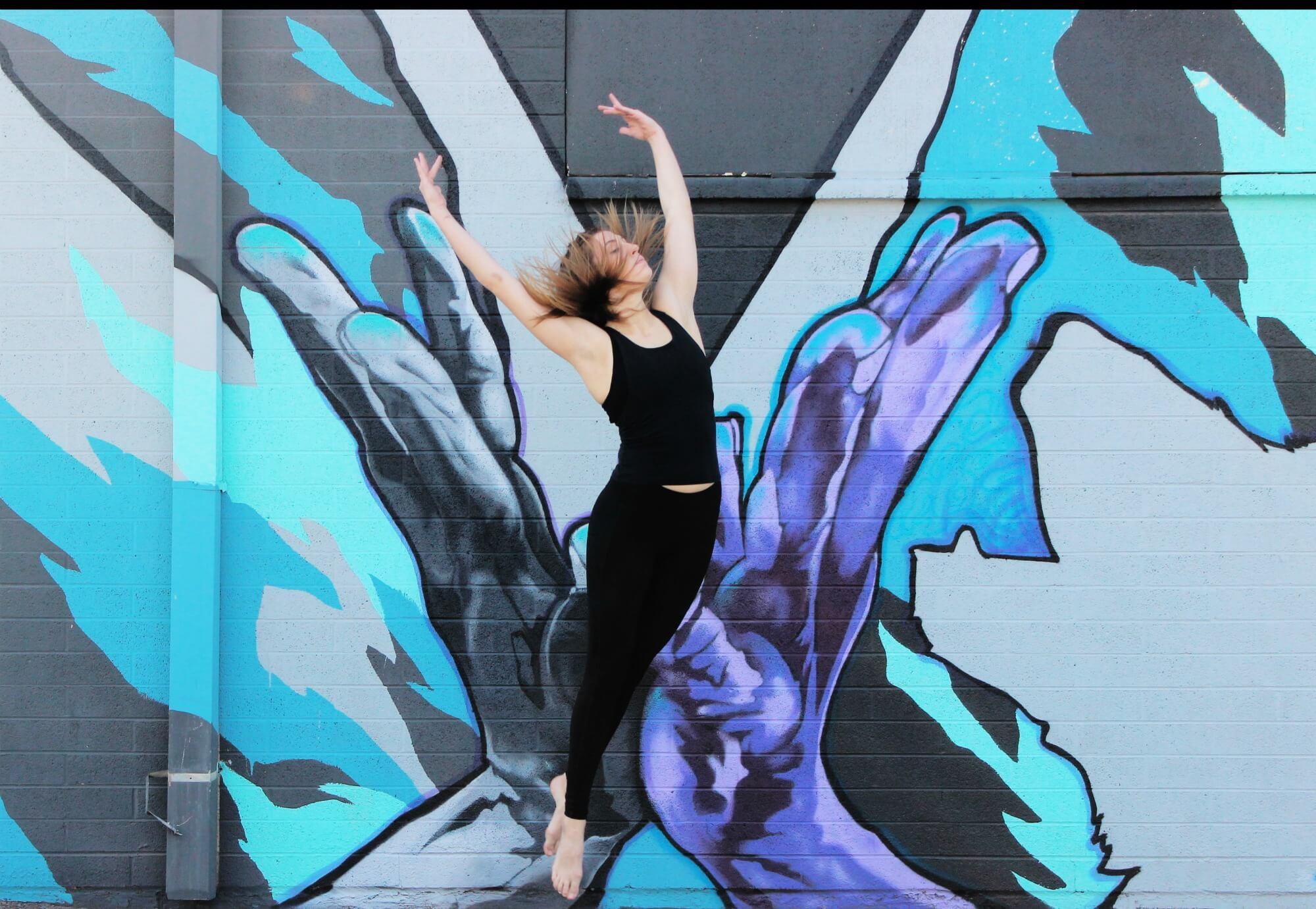 Dancer Randee Powell in front of a mural by Joerael JE. Photo: Ashley Baker.