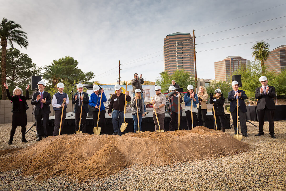 Denise D. Resnik, First Place Founder; and Phoenix Mayor Greg Stanton join adults with autism in breaking ground on First Place-Phoenix. Photo credit: Stephen G. Dreiseszun/Viewpoint Photographers